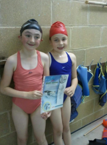Angela's Swim School instructor as a child with swimming award