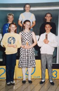 A young Angela Wilson with other swimming winners